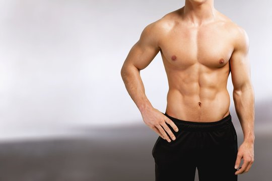 Cropped image of fit muscular body of sportsman
