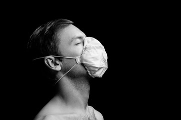 man in respirator on black background