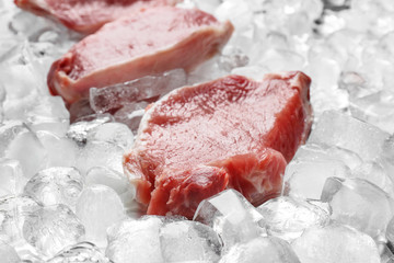 Fresh raw meat on ice cubes, closeup