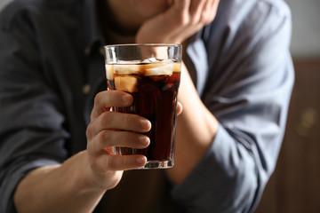 Tuinposter Bar Man with glass of cold cola indoors, closeup