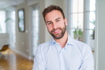 Handsome business man happy face smiling with crossed arms looking at the camera. Positive person. Wall mural