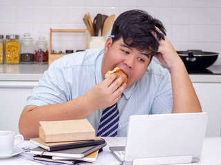 Diet failure of fat man eating fast food unhealthy hamberger.