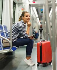 Girl traveler in underground coach