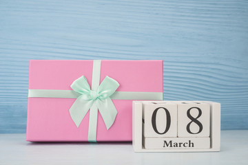 Gift box and wooden cubic calendar with date of March 8