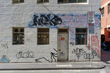 Grafitti on white brick building
