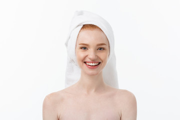 Surprised Beautiful Young Woman After Bath with A Towel On Her Head Isolated On white Background. Skin Care And Spa Theme.