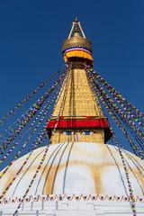 Boudhanath in Nepal. Cultural heritage in Kathmandu. The Biggest Tibetan temple. Nepalese prayer flags.