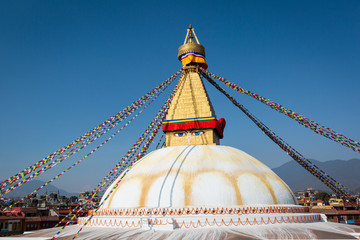 Boudhanath in Nepal. Cultural heritage in Kathmandu. The Biggest Tibetan temple. Nepalese prayer flags. bottom frame outlines of the city