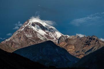 Kazbek mountain in the light of the rising sun