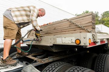 Truck driver attaching trailer to semi-truck