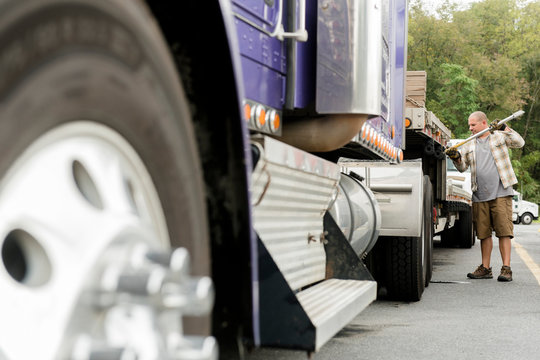 Truck driver working on semi-truck