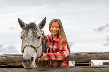 Smiling girl with horse