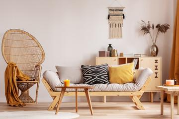 Wicker peacock chair in elegant living room interior