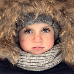 Boy with fur hood and scarf