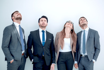 group of business people looking up at a copy space