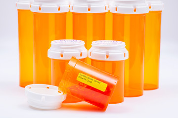 Docusate sodium soft gel capsules in orange container with SWALLOW WHOLE DO NOT CHEW OR CRUSH LABEL.