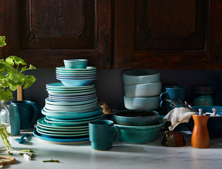Assorted Blue Dishes in Front of Rustic Cabinet