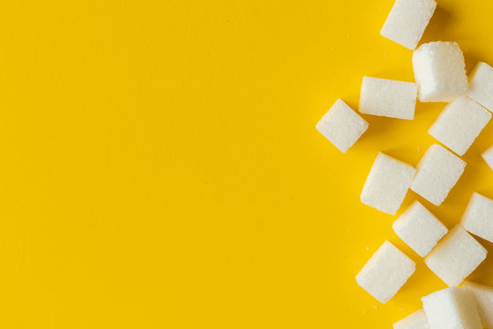 sugar cube on yellow background isolated design mockup b