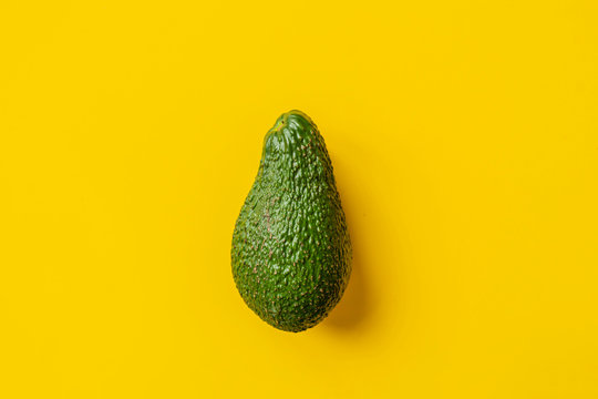 fresh avoado on yellow background isolated text design b