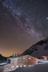 Starry night with a view of milky way galaxy over the cottage in atlas mountains Morocco Africa