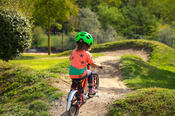 -small child is riding a bike in a bike parcours Fototapete