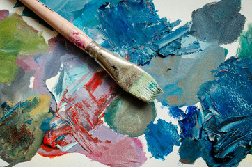 Artist paint brush on the wooden palette