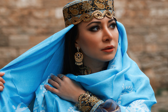 Beautiful middle eastern woman wearing traditional dress, posing outdoors