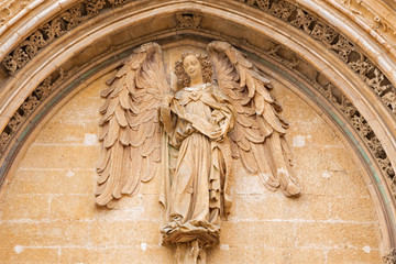Wall Mural - PALMA DE MALLORCA, SPAIN - JANUARY 29, 2019: The detail of portal of La Lonja palace constructed by Guillem Sagrera (1420 - 1452) with the guardian angel statue.