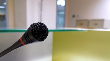 Close up image of a microphone on the receptionist counter table.