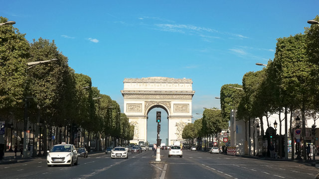 morning view of the arc de triomphe and the avenue champs de elysees