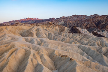 Dissected Hills and Alpenglow seen from Zebraskia Point in Death Valley National Park, California, USA.