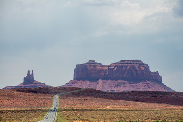 US Highway 163 curves around sandstone prominances in Monument Valley