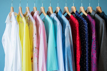 Women clothes hanging in row in closet