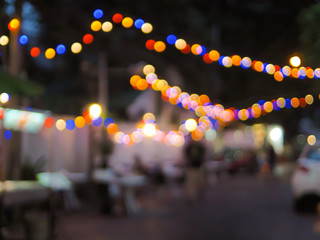 Vintage tone colorful of light abstract blur image of Night festival on street with light bokeh for background usage