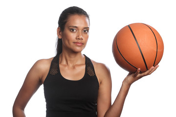 Mixed race womens basketball player holding ball