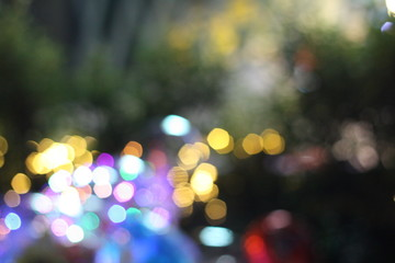 Beautiful bokeh in city night life. Wonderful light decorating during Christmas and New Year celebrating..