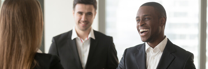 Horizontal image diverse multiracial businesspeople acquainted meet at office