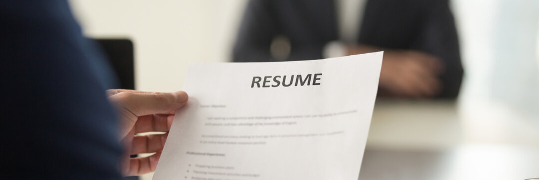 Boss holding resume cv paper interviewing vacancy candidature panoramic image