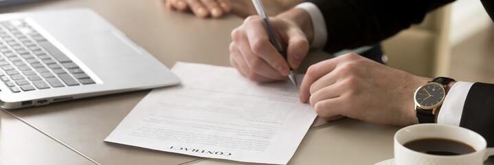 Closeup hands businessman sitting at desk accomplish meeting signing contract