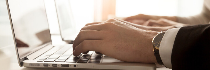 Horizontal image businessmen typing on computer hands and keyboard closeup