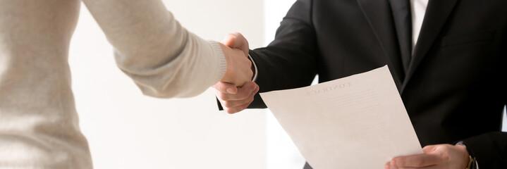 Horizontal closeup view businesspeople shaking hand starting job interview