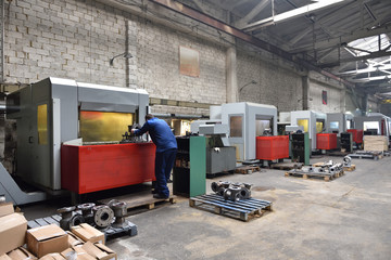 CNC machines at the plant for the production of valves. Factory workspace