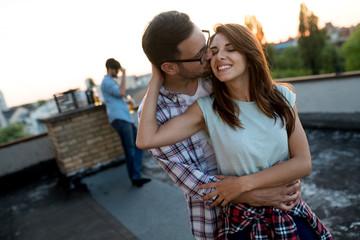 Couple in love enjoying in sunset in a terrace