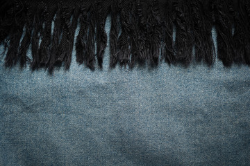 Background of blue jeans and black cloth fabric texture backdrop.