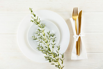 Table setting arrangement in minimal style with easter spring holiday attributes, fork, knife and napkin. Background, copy space, close up, flat lay, top view. Fototapete