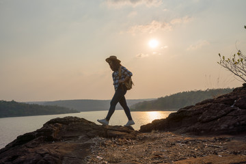 Young woman hipster hiking on holiday of her