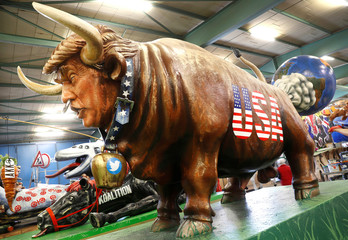 A paper mache bull depicting U.S. President Donald Trump is seen during the presentation of the floats for the upcoming Rose Monday parade in Mainz