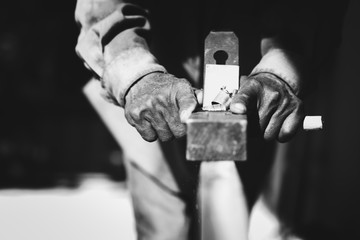 In the hands of a carpenter there is spokeshave.