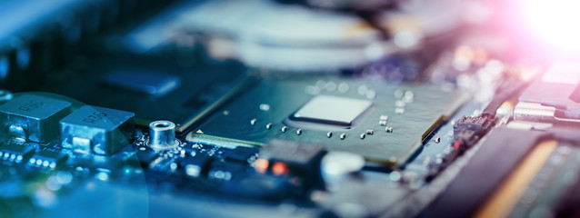 Computer Technology: Close up of a computer chip on a circuit board. Light effect.