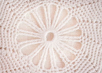 Patterns of white or light brown crochet knitted texture in flowers patterns for background , crafts
